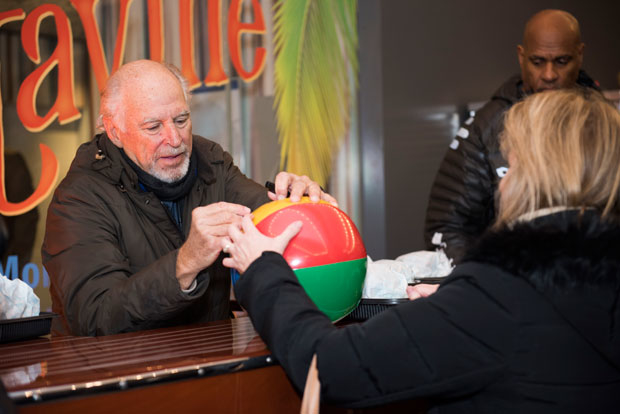 Jimmy Buffett signs a beach ball.