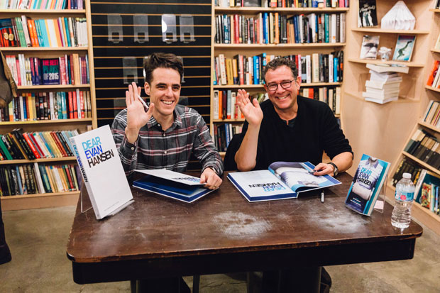 Steven Levenson and MIchael Greif sign books for fans at Dear Evan Hansen.