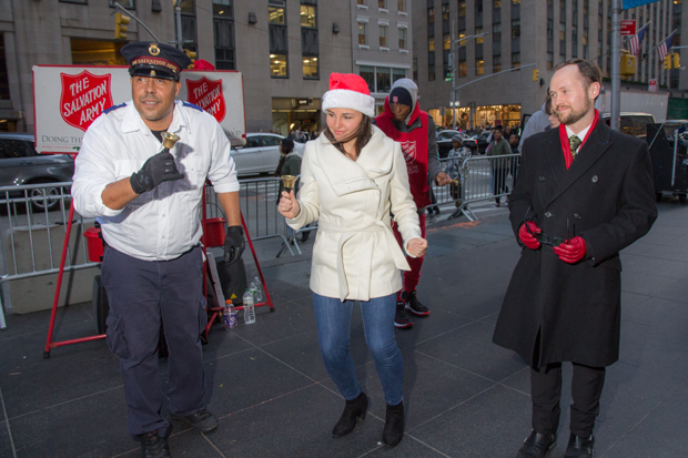 "Hayley dances with the Salvation Army to Mariah Carey's ""All I Want for Christmas is You"" as Zach looks on."