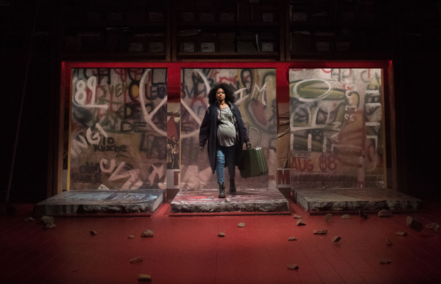 Rebecca Naomi Jones during the fall of the Berlin Wall, with the rocks scattered around the stage.