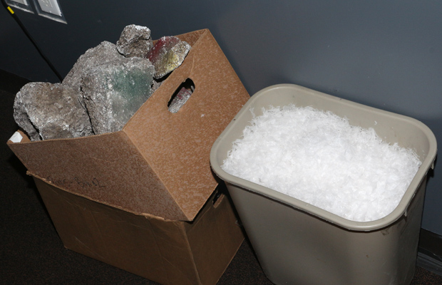 A box of rocks and a garbage pail of snow await their stage time.