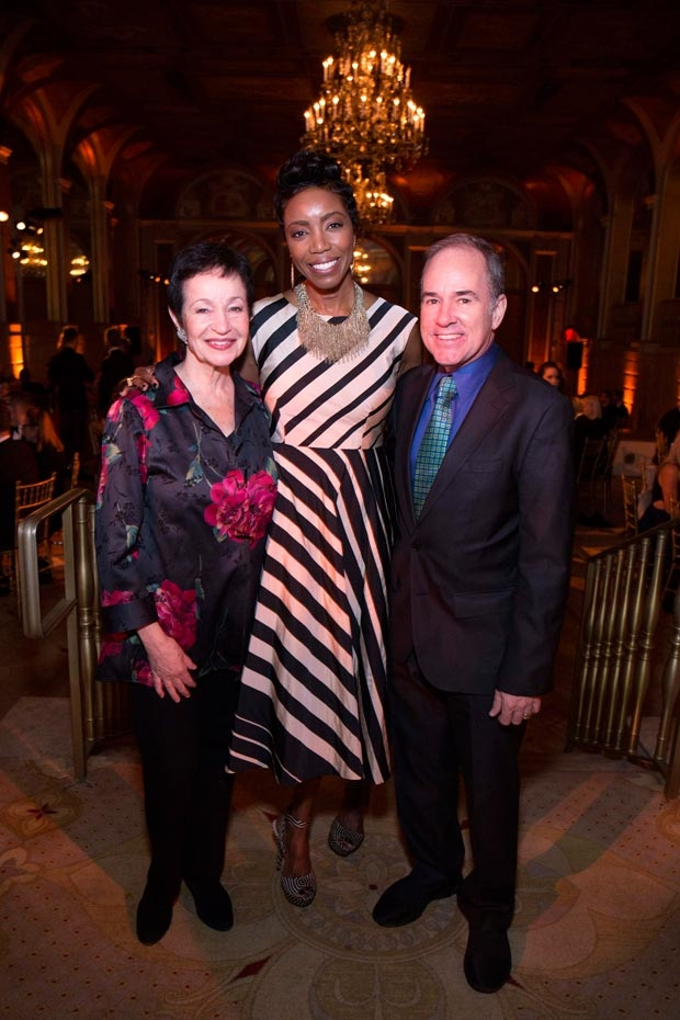 Honoree Heather Headley grabs a photo with last year's honorees: Lynn Ahrens and Stephen Flaherty.
