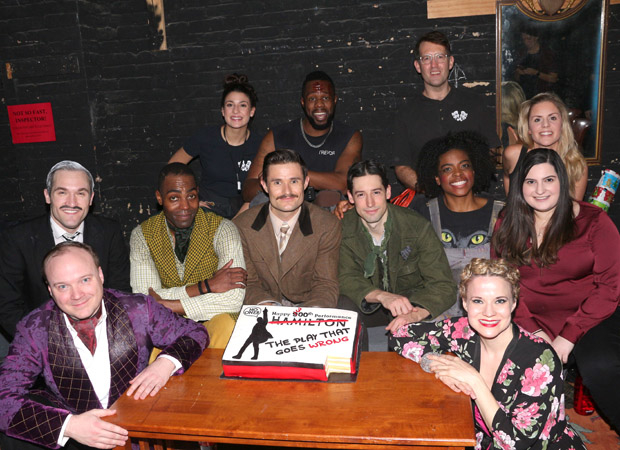 Baker Dina Jawetz (right, in maroon) gets a quick photo with the cast and her cake.