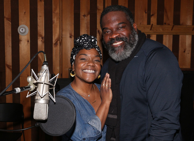 Kenita R. Miller and Phillip Boykin share a microphone.