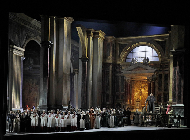 The chorus sings a Te Deum during the first act finale of Tosca at the Metropolitan Opera.