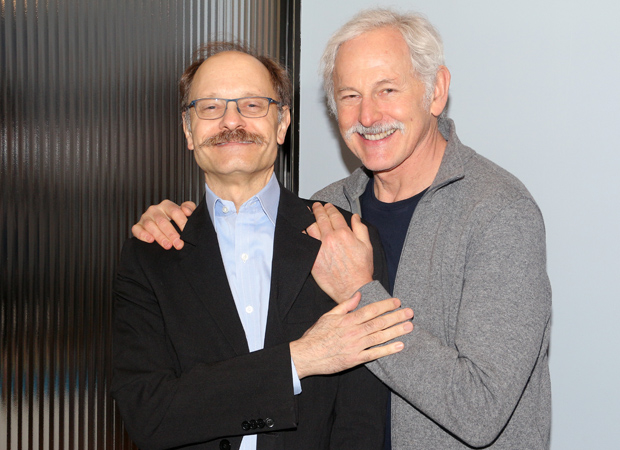 A friendly moment with David Hyde Pierce and Victor Garber.