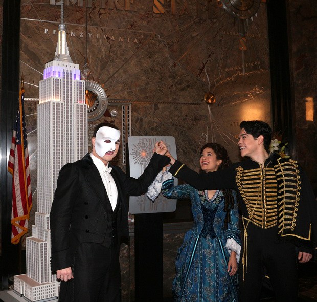 In costume, Peter Jöback, Ali Ewoldt, and Rodney Ingram flip the switch to light the Empire State Building in honor of The Phantom of the Opera.