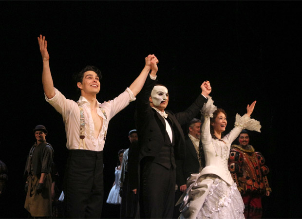 Rodney Ingram, Peter Jöback, and Ali Ewoldt take their bow during the 30th anniversary performance of The Phantom of the Opera.