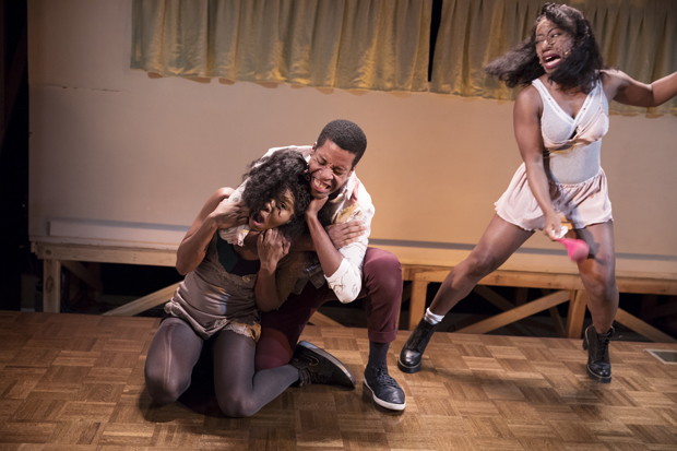 Dame-Jasmine Hughes, Anthony Cason, and Alfie Fuller perform one of the fight sequences in Is God Is.
