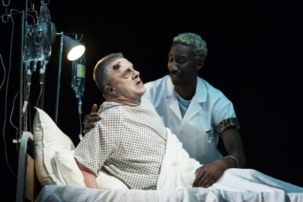 Nathan Lane (Roy Cohn) and Nathan Stewart-Jarrett (Belize) in a scene from the National Theatre production of Angels In America Perestroika