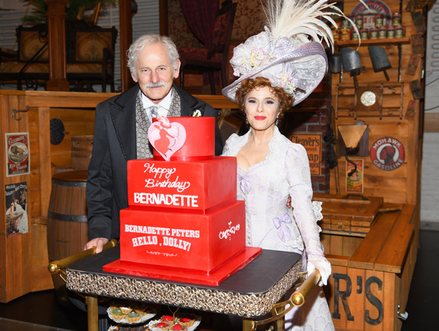 Victor Garber and Bernadette Peters pose with Peters's Dolly-themed birthday cake.
