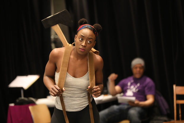 Ito Aghayere (foreground) and Kevin Mambo (background) star in Mlima's Tale, directed by Jo Bonney, at the Public Theater.