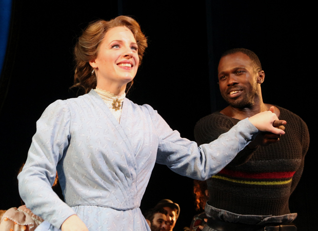 Jessie Mueller takes a bow as Joshua Henry looks on.