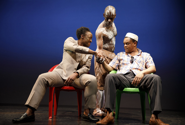 Mlima (Sahr Ngaujah, center) marks two ivory traders (Ito Aghayere and Kevin Mambo) as they shake on a deal over his tusks in Mlima's Tale.