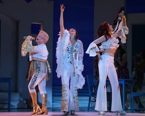 Charis Leos, Anne Brummel, and Lyn Philistine star in Mamma Mia! at Walnut Street Theatre.