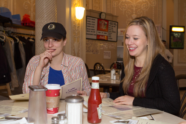 Bad Jews cast members Tracee Chimo and Molly Ranson face a tough decision: what to order at the Café Edison.