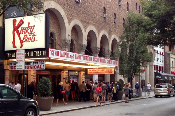 Broadway fans looking for a deal gather around for the lottery drawing for Kinky Boots.