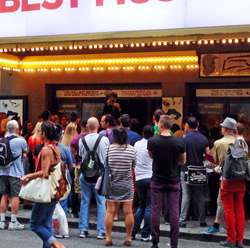 Fans regularly spill off the sidewalk into 49th street, hoping their names will be drawn in the Book of Mormon lottery.