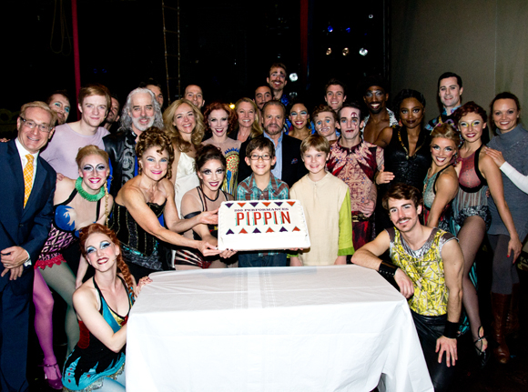 Cast and creative team members of Broadway's Pippin pose with their commemorative cake.