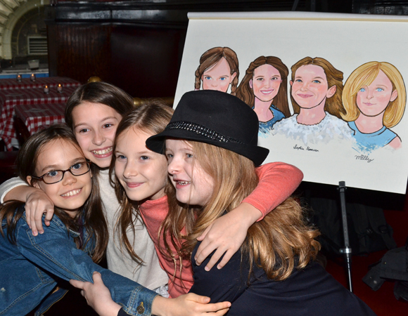 Oona Laurence, Bailey Ryon, Sophia Gennusa, and Milly Shapiro share a group hug.