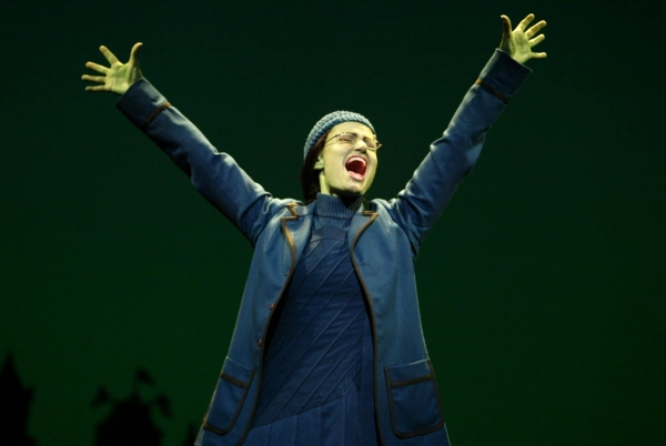 Idina Menzel as the emerald-green Elphaba.