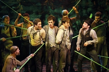 Adam Chanler-Berat as Peter with his starcatchers in the New York Theatre Workshop premiere of Peter and the Starcatcher.