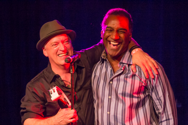Norm Lewis and director Donnie Kehr share a hug onstage.