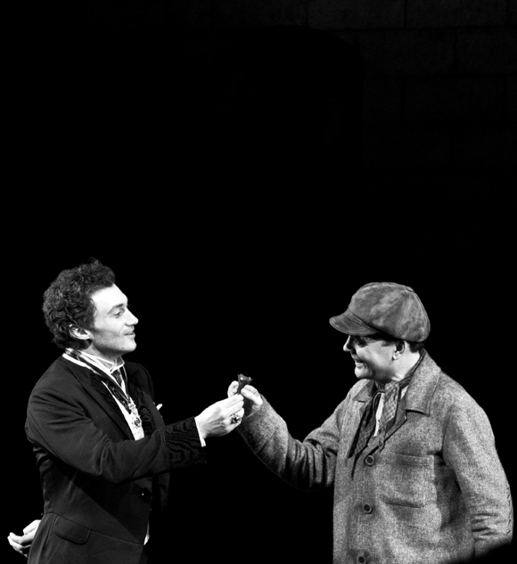 Bryce Pinkham and Jefferson Mays share a moment with a (poisonous?) belladonna flower at the end of the show.