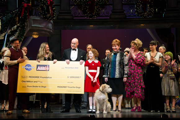 The cast of Annie presents Pedigree Foundation representatives with a check for $1 million.