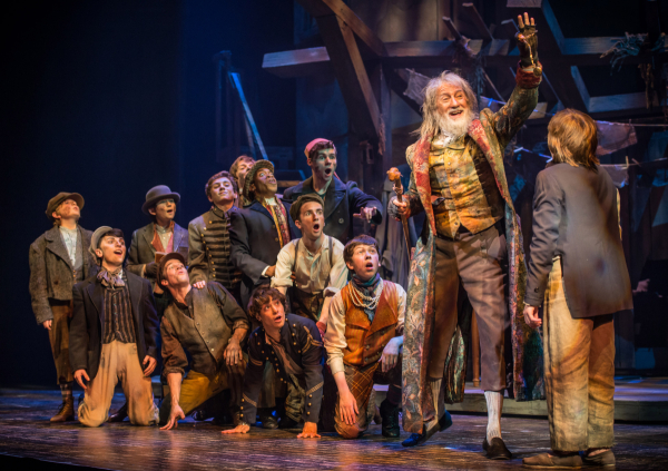 David Garrison and the cast of Oliver! at Paper Mill Playhouse.
