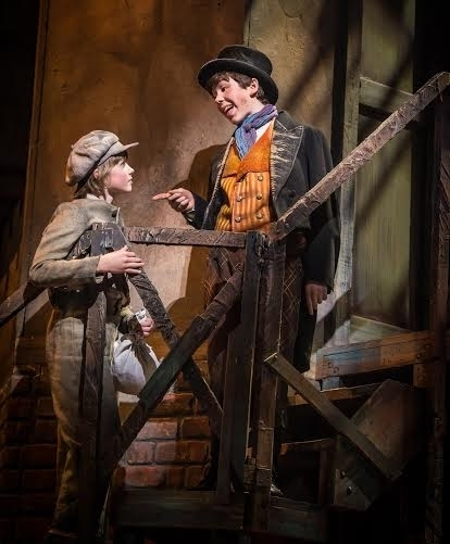 Tyler Moran (Oliver) and Ethan Haberfield (Artful Dodger) in Oliver! at Paper Mill Playhouse.