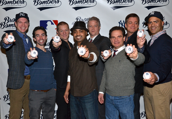 The men of Bronx Bombers show off their Yankees baseballs.