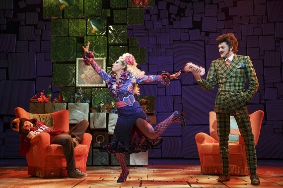 (l to r): Taylor Trensch as Michael Wormwood, Lesli Margherita as Mrs. Wormwood, and Gabriel Ebert as Mr. Wormwood in Matilda at Broadway's Shubert Theatre.