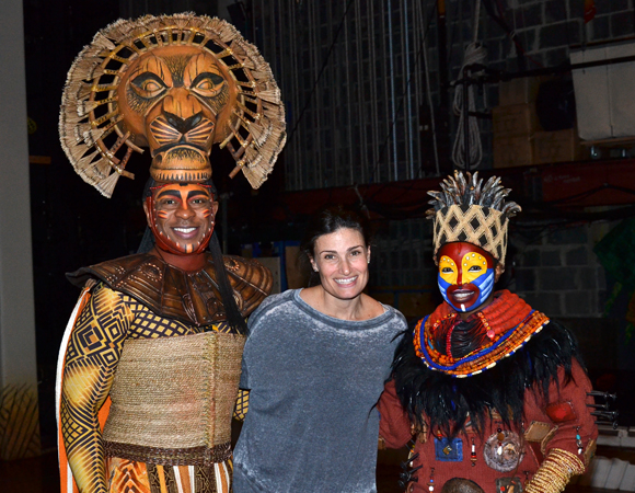 Lion King stars Alton Fitzgerald White (Mufasa) and Mukelisiwe Goba (Rafiki) flank backstage guest Idina Menzel at the Minskoff Theatre.