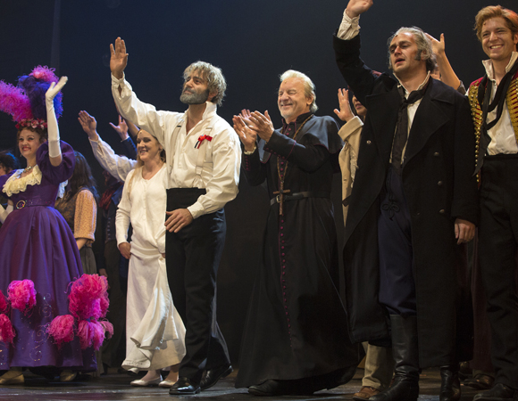 The Toronto cast of Les Misérables take their bows at the Prince of Wales Theatre.