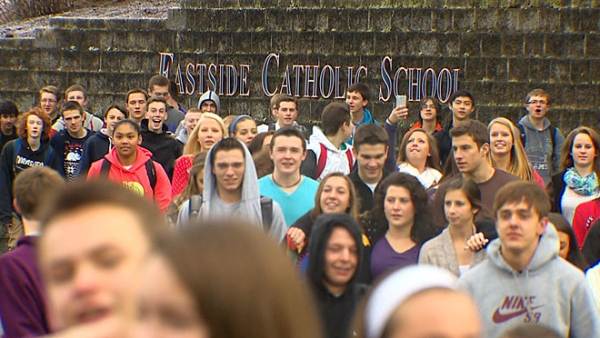 Students rally outside Seattle's Eastside Catholic School in protest of the firing of their teacher for marrying his same-sex partner.