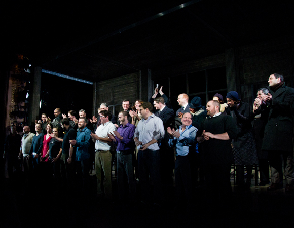 The cast of Machinal is joined onstage for a post-performance bow by the volunteer stagehands who helped spin the broken turntable throughout the show.