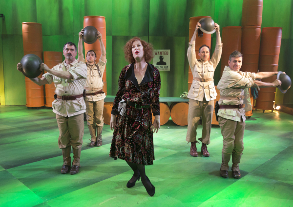 Steven Skybell, Jason Babinsky, Gibson Frazier, and Martin Moran play four machine gunners in Her Majesty's army. They dance around Justin Vivian Bond, who plays the Widow Begbick in A Man's A Man at Classic Stage Company.