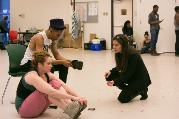 Cocreator Griffin Matthews, who also stars in Witness Uganda at A.R.T., works through a scene with actress Emma Hunton and director Diane Paulus during rehearsal.