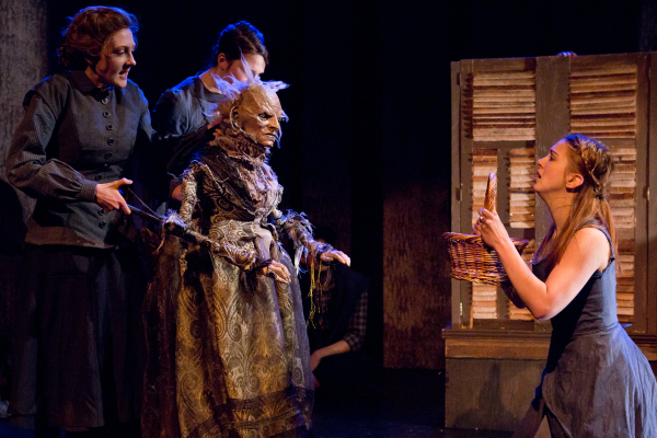 Amanda Adele Lederer and Carol Uraneck operating the Witch of the East puppet with Eliza Simpson in the role of Nimmie in The Woodsman at 59E59 Theaters.