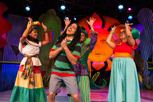 Jobari Parker-Namdar (front) as Ziggy, along with (from left) Tara Lynn Yates-Reeves, David Little, and Ayanna Hardy, in Bob Marley's Three Little Birds, directed by Nick Olcott, at the New Victory Theater.