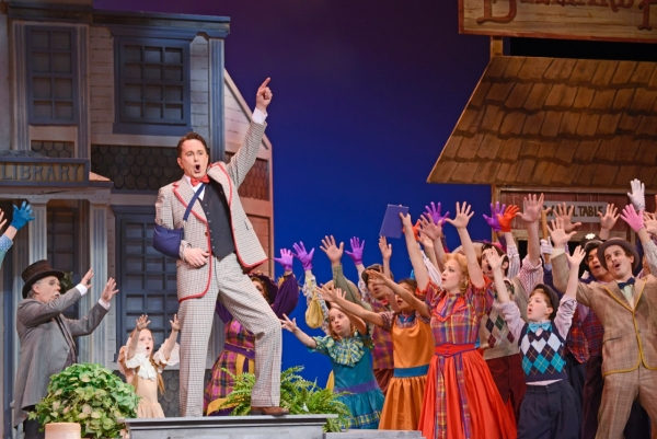 Davis Gaines as Professor Harold Hill with the company of Musical Theatre West's production of Meredith Willson's The Music Man, directed by Jeff Maynard, now playing at the Carpenter Center for the Performing Arts in Long Beach.