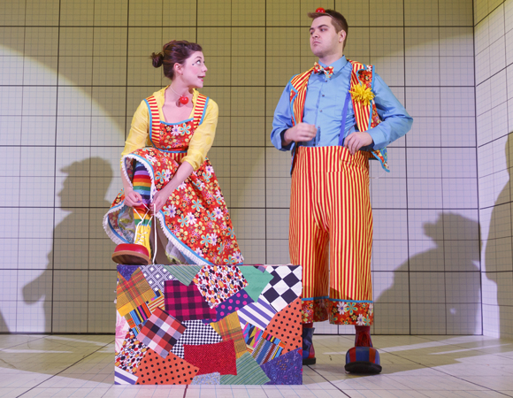 In a scene from Caryl Churchill's Love and Information, a production of New York Theatre Workshop directed by James Macdonald, Susannah Flood and Nate Miller play clowns getting ready to perform at a party.