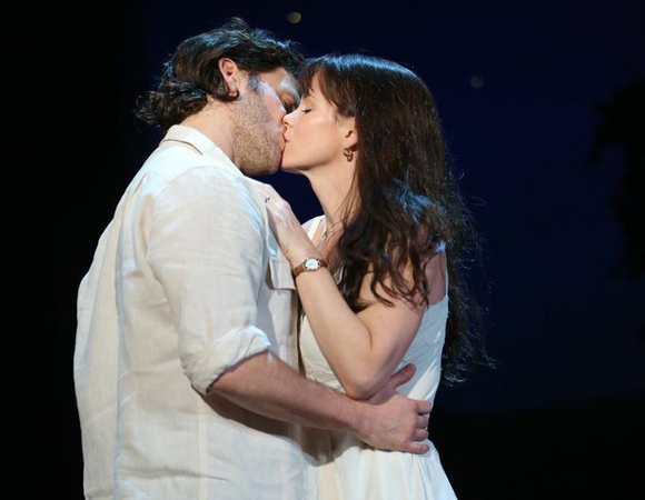 Steven Pasquale and Kelli O'Hara share a kiss in Jason Robert Brown and Marsha Norman's new musical adaptation of The Bridges of Madison County, directed by Bartlett Sher, at the Gerald Schoenfeld Theatre.