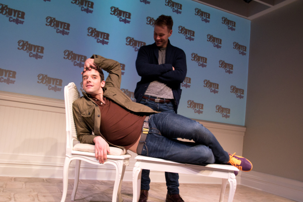 Michael Urie shows Christopher J. Hanke how to take advantage of the Buyer and Cellar's set.