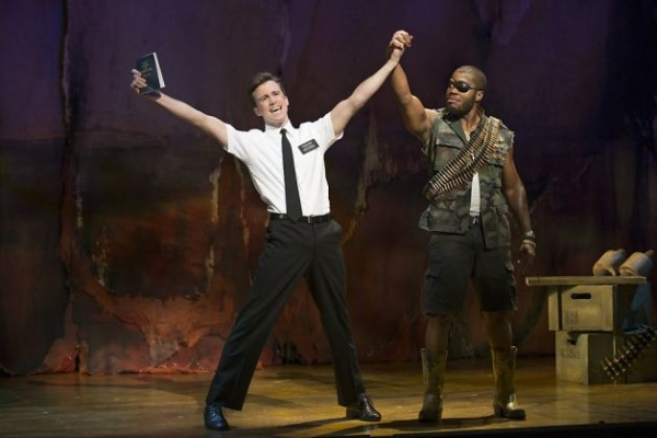 Gavin Creel (left) is a WhatsOnStage Award winner for his performance as Elder Price in the London production of The Book of Mormon. (He stands beside Derrick Williams as a Ugandan warlord.)