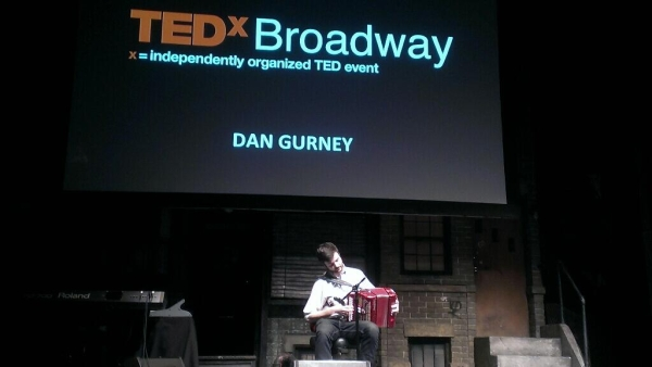 Dan Gurney opens his TED talk with a tune on the button accordion.