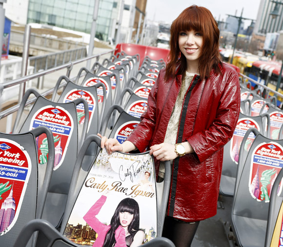 Jepsen stands in front of her Cinderella-inspired seat on the upper deck of her newly-commemorated tour bus.