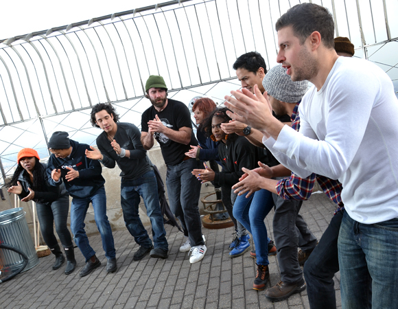 It might be freezing atop the Empire State Building, but that doesn't stop the Stomp-ers from doing a celebratory performance.