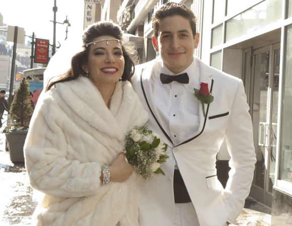 Tina (Marilia Angeline) and Tony (Joe Ferraro) get married in a scene from Tony n' Tina's Wedding.